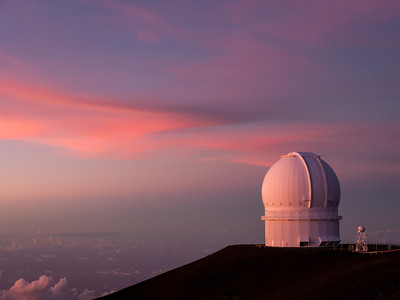 Sunset at the observatories on the summit of Mauna Kea, Mauna Kea Summit Adventures Tour, Hawaii (Big Island), HI.